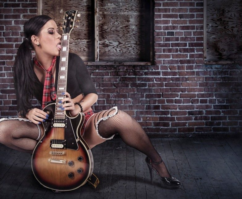 A women who loves playing guitar